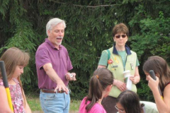 Keith-Hayes, President providing instruction on the planting of a native species