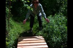 Nancy Gable celebrates the new bridge in Mill Pond Park